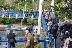 Licensed to London News Pictures. 10/05/2021. London, UK. Crowds of well wishers flock to see a rescue attempt of a stricken whale as RNLI experts race against time to rescue and re-float the young whale which has been caught up in bushes at Teddington Lock, south west London this afternoon. The 4 metre baby mink whale was first seen stuck at Richmond Lock yesterday evening and was freed at 1am this morning. However the disoriented whale turned away from the direction of the open seas and headed west towards Teddington. Photo credit: Alex Lentati/LNP
