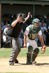 14 April 2013:  A.J. Nathan looks for the ball as umpire Steve Jones signals a batter hit by a pitch during an NCAA division 3 College Conference of Illinois and Wisconsin (CCIW) Baseball game between the Elmhurst Bluejays and the Illinois Wesleyan Titans in Jack Horenberger Stadium, Bloomington IL