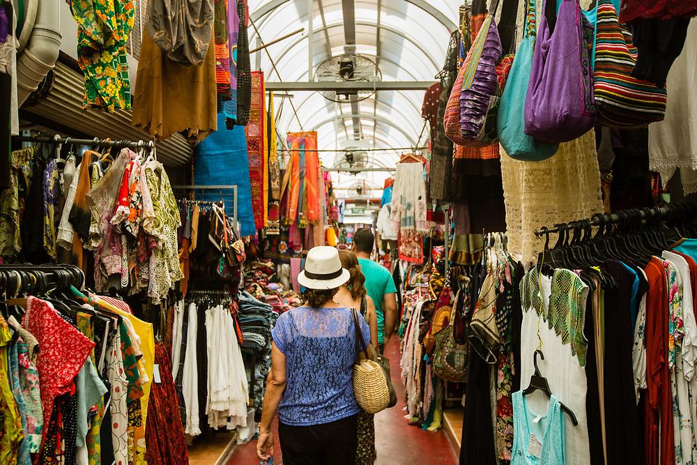 People are seen shopping at Shuk Hapishpeshim (Flea Market) in Jaffa