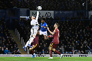 Will Norris (12) of Ipswich Town denies Ellis Harrison (22) of Portsmouth as scoring chance during the EFL Sky Bet League 1 match between Portsmouth and Ipswich Town at Fratton Park, Portsmouth, England on 21 December 2019.