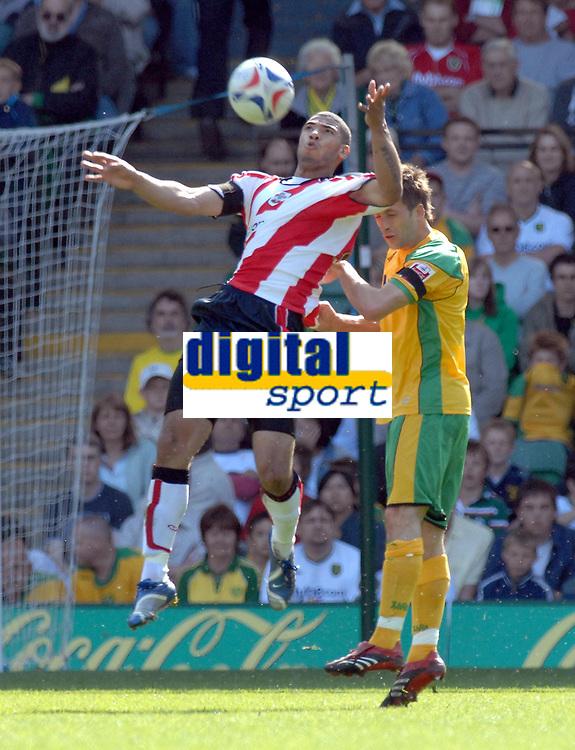 Photo: Ashley Pickering.<br /> Norwich City v Southampton. Coca Cola Championship. 28/04/2007.<br /> Leon Best of Southampton (L) wins the ball from Adam Drury