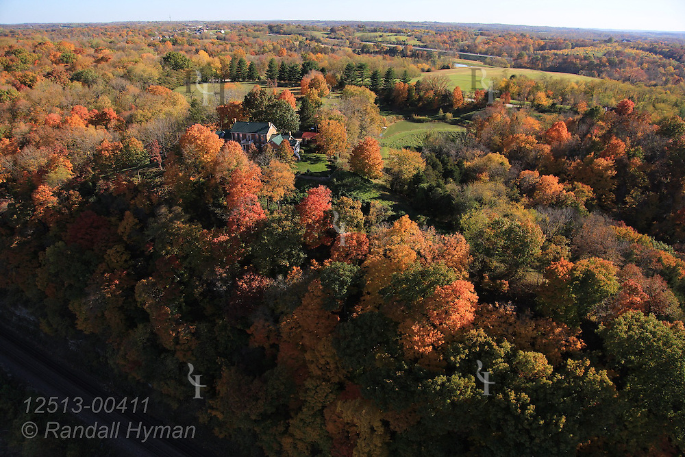 Aerial view of farms and homes along colorful Missouri River bluffs in autumn off Old Highway 100 downstream from Washington, Missouri.