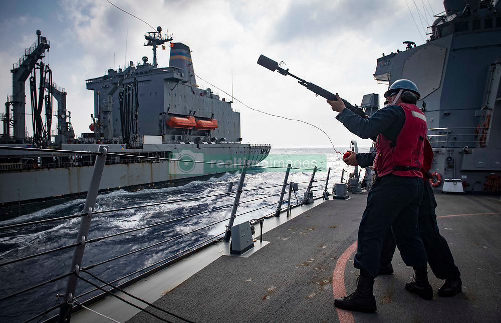 MEDITERRANEAN SEA (Aug. 3, 2018) Sailors fire a shot line to the Military Sealift Command fast-combat support ship USNS Leroy Grumman (T-AOE 195) from aboard the Arleigh Burke-class guided-missile destroyer USS Carney (DDG 64) during a replenishment-at-sea Aug. 3, 2018. Carney, forward-deployed to Rota, Spain, is on its fifth patrol in the U.S. 6th Fleet area of operations in support of regional allies and partners as well as U.S. national security interests in Europe and Africa. (U.S. Navy photo by Mass Communication Specialist 1st Class Ryan U. Kledzik/Released)180803-N-UY653-089