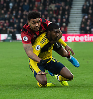 Arsenal's Ainsley Maitland-Niles (right) is tackled by Bournemouth's Joshua King (left) <br /> <br /> Photographer David Horton/CameraSport<br /> <br /> The Premier League - Bournemouth v Arsenal - Thursday 26th December 2019 - Vitality Stadium - Bournemouth<br /> <br /> World Copyright © 2019 CameraSport. All rights reserved. 43 Linden Ave. Countesthorpe. Leicester. England. LE8 5PG - Tel: +44 (0) 116 277 4147 - admin@camerasport.com - www.camerasport.com