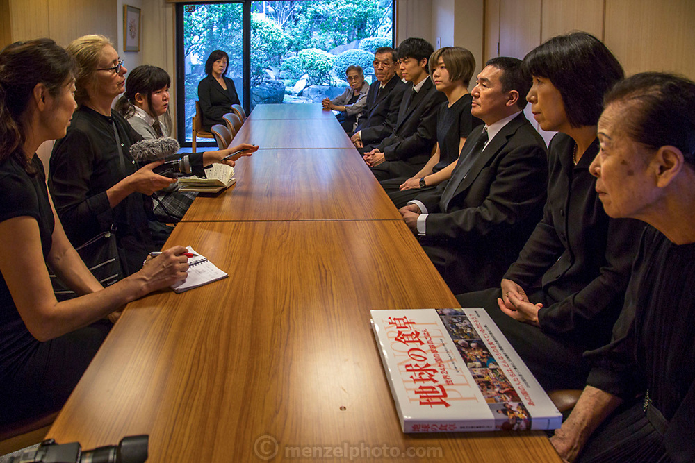 Faith D'Aluisio asks a family about their remembrance of an ancestor in a Tokyo suburb memorial garden. Japan