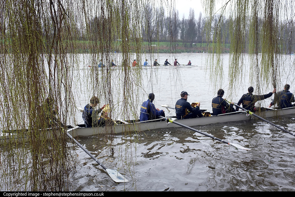 © Licensed to London News Pictures. 17/03/2012. London, UK. A crew waits near the river bank to take their staring position. Crews participate in the rain today,  Saturday 17th March, in The Head of the River Race which is rowed annually in March from Mortlake to Putney on the River Thames in London.  Over 400 crews of eights take part, making it one of the highest participation events in London.. Photo credit : Stephen SImpson/LNP