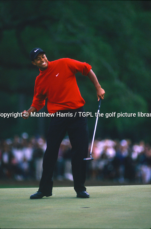 The moment a new golf superstar was born as Tiger WOODS (USA) punches the air having made a birdie on the 18th par 4 to win his first major during fourth round US Masters 1997,Augusta,Georgia,USA.