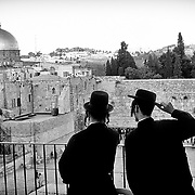 Visitors to Western Wall, Dome of the Rock at background.Jerusalem. Israel.