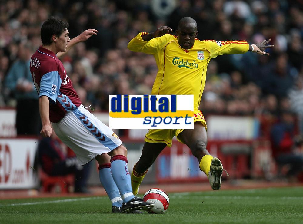 Photo: Rich Eaton.<br /> <br /> Aston Villa v Liverpool. The Barclays Premiership. 18/03/2007. Gareth Barry left of Villa clears under pressure from Momo Sissoko