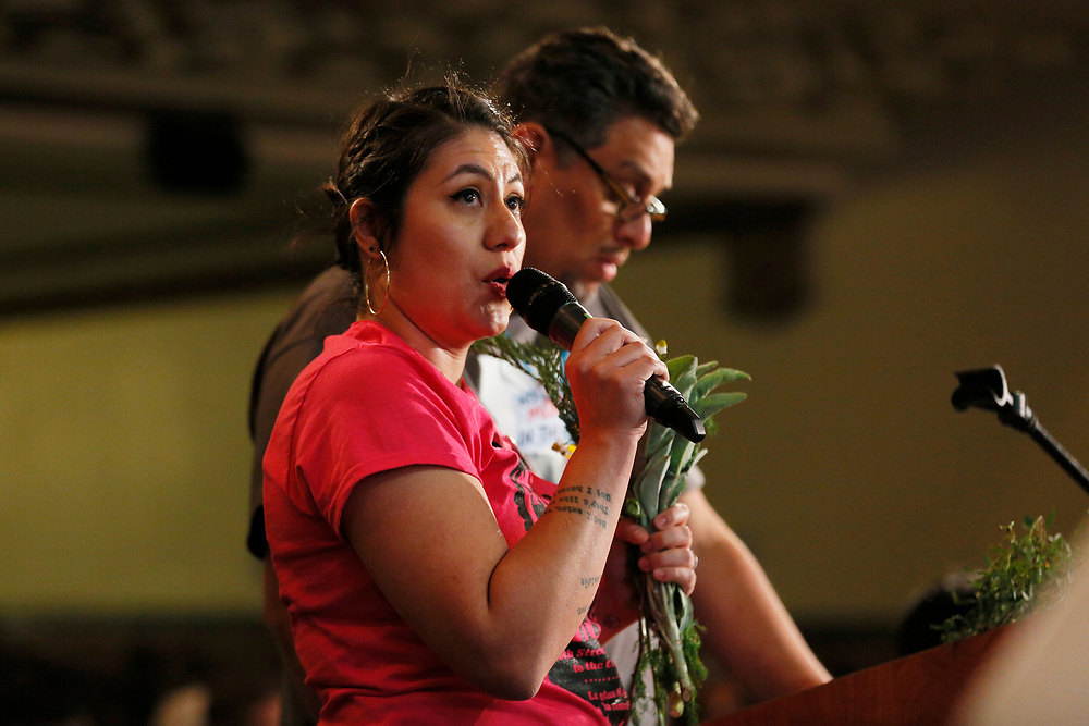 """Maria Zamudio speaks against the housing project often referred by critics as the """"Monster in the Mission,"""" on Thursday, Feb. 7, 2019, in San Francisco, Calif. The public meeting was held at Mission High School to hear public reaction on the housing project for 1979 Mission Street."""