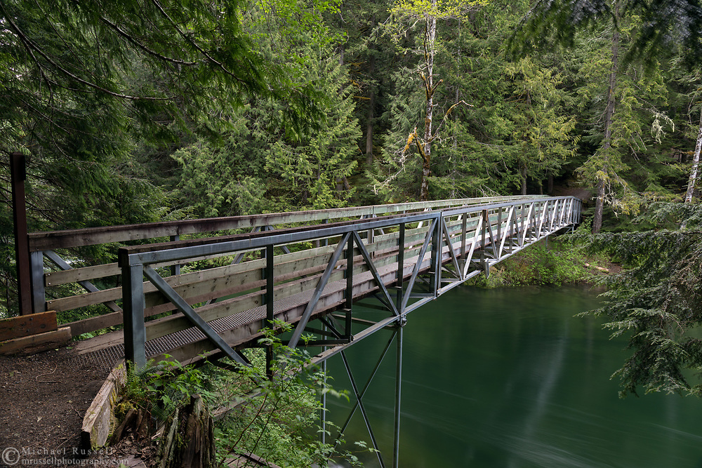 Bridge over the start of the Chilliwack River at Chilliwack Lake.  This trail is part of the Trans Canada Trail and is also the start of the Radium Lake Trail up Mount Webb.  Photographed in Chilliwack Lake Provincial Park, British Columbia, Canada.