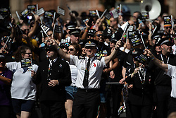 © Licensed to London News Pictures . 24/08/2019. Manchester, UK. Chief Constable IAN HOPKINS leads GMP parade entry . The 2019 Manchester Gay Pride parade through the city centre , with a Space and Science Fiction theme . Manchester's Gay Pride festival , which is the largest of its type in Europe , celebrates LGBTQ+ life . Photo credit: Joel Goodman/LNP