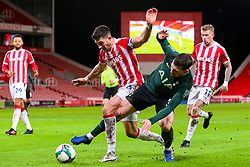 Pierre-Emile Hojbjerg of Tottenham Hotspur tangles with Danny Batth of Stoke City - Mandatory by-line: Nick Browning/JMP - 23/12/2020 - FOOTBALL - Bet365 Stadium - Stoke-on-Trent, England - Stoke City v Tottenham Hotspur - Carabao Cup