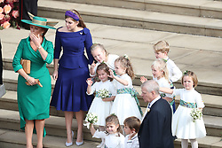 Sarah Ferguson, Princess Beatrice and the bridesmaids and page boys, including Princess Charlotte and Prince George wave off Princess Eugenie and her new husband Jack Brooksbank as they leave St George's Chapel in Windsor Castle following their wedding.