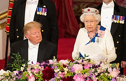 US President Donald Trump listens as Queen Elizabeth II makes a speech during the State Banquet at Buckingham Palace, London, on day one of President Trump's three day state visit to the UK.