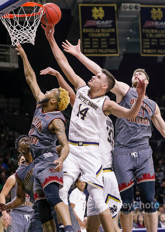 SOUTH BEND, IN - JANUARY 12: Nate Laszewski #14 of the Notre Dame Fighting Irish shoots the ball against Ky Bowman #0 of the Boston College Eagles at Purcell Pavilion on January 12, 2019 in South Bend, Indiana. (Photo by Michael Hickey/Getty Images) *** Local Caption *** Nate Laszewski; Ky Bowman