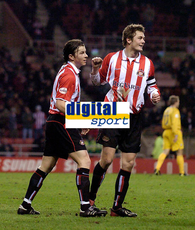 Photo. Jed Wee.<br /> Sunderland v Preston North End, Nationwide League Division One, Stadium of Light, Sunderland. 10/03/2004.<br /> Sunderland's John Oster (L) celebrates with opening goal with Sunderland skipper George McCartney.