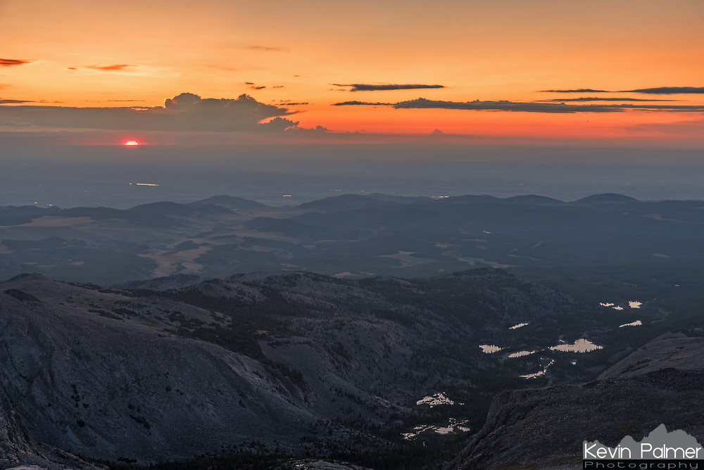 Standing on top of a 12,275' mountain, it's likely I was the first person in Wyoming to see the sun on this particular day. I'm not sure what all the lakes are named in this shot, but the biggest one is Willow Lake.