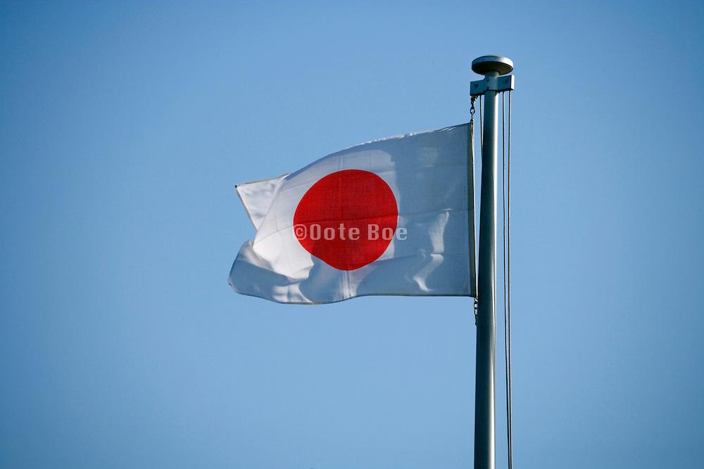 Japanese flag against a blue sky