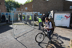 London, UK. 23 September, 2015. Housing activists carry their possessions from properties on the Sweets Way housing estate after having been evicted by bailiffs. A group of housing activists calling for better social housing provision in London occupied properties on the 142-home estate in Whetstone, in a few cases refurbishing properties intentionally destroyed by the legal owners following eviction of the original residents, in order to try to prevent the eviction of the last resident on the estate and the planned demolition and redevelopment of the entire estate by Barnet Council and Annington Property Ltd.