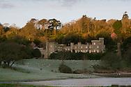 Sunrise at Caerhays Castle during the Magnolia season in February, St Austell, Cornwall, UK