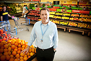 4/14/10 1:18:51 PM -- Bentonville, AR, U.S.A. -- Doug McMillon, the CEO of Walmart International, poses for a portrait in the produce section of the Wal-Mart near the home office in Bentonville, AR for the Advice From the Top feature running Monday, April 19, 2010. --  ...Photo by Shane Bevel, Freelance