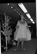 09/03/1964<br /> 03/09/1964<br /> 09 March 1964<br /> McBirney's Fashion show at McBirney's, Aston Quay, Dublin. Model Carol displaying a Negligee and Nightgown from the collection.