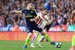 13th May 2017 - Premier League - Stoke City v Arsenal - Granit Xhaka of Arsenal battles with Xherdan Shaqiri of Stoke - Photo: Simon Stacpoole / Offside.