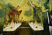 The rotunda with the four elements painting by Gerard garouste water earth air wind fire in a tent decoration showing some of the baccarat masterpieces. At The Baccarat museum, shop, restaurant at the Hotel de Noailles in Paris. Designed by Philippe Starck. The Baccarat Museum: one of the rooms designed like a desert tent