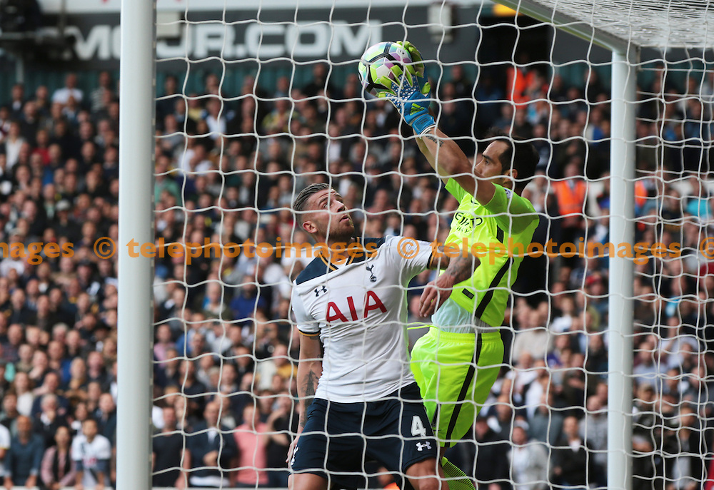 Manchester City's Claudio Bravo under pressure from Tottenham Hotspur's Dele Alli<br /> during the Premier League match between Tottenham Hotspur and Manchester City at White Hart Lane in London. October 1, 2016.<br /> James Galvin / Telephoto Images<br /> +44 7967 642437