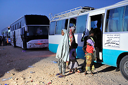 Migrants pray during a stop in Algeria, June 29, 2018 on their way from Algiers to Tamanrasset, 2,000 km south of Algiers. Nigerian illegal migrants (majority of women and children) who lived in Algeria by begging, according to the Algerian authorities, will be returned to their country once the administrative arrangements are completed. Photo by Louiza Ammi/ABACAPRESS.COM