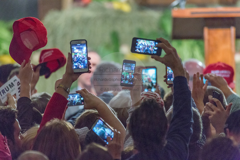 Supporters hold up camera phones as billionaire and GOP presidential candidate Donald Trump greets supporters at a rally January 27, 2016 in Lexington, South Carolina.