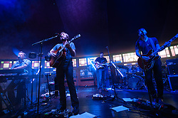 © Licensed to London News Pictures. 12/07/2014. London, UK.   Midlake performing live at Hyde Park as part of the British Summer Time series of outdoor concerts.  In this picture - Jesse Chandler (far left), Eric Nichelsen (2nd from left), Joey Mclellan (right), Paul Alexander (2nd from right).   Midlake are an American folk rock band consisting of members McKenzie Smith (drums), Paul Alexander (bass), Eric Nichelson (guitar/lead vocals), Eric Pulido, Jesse Chandler (keyboards),Joey McClellan (guitars).Photo credit : Richard Isaac/LNP