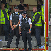 Police van stand by watching Hundreds of students and young people strike from school, even is rain attend the Youth Strike 4 Climate nationwide demand world leaders to act now at Parliament Square on 19 July 2019, London, UK