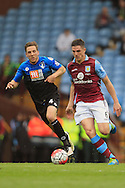 Ciaran Clark of Aston Villa (R) in action with Dan Gosling of Bournemouth.<br /> Barclays Premier League match, Aston Villa v AFC Bournemouth at Villa Park in Birmingham, The Midlands on Saturday 09th April 2016.<br /> Pic by Ian Smith, Andrew Orchard Sports Photography.