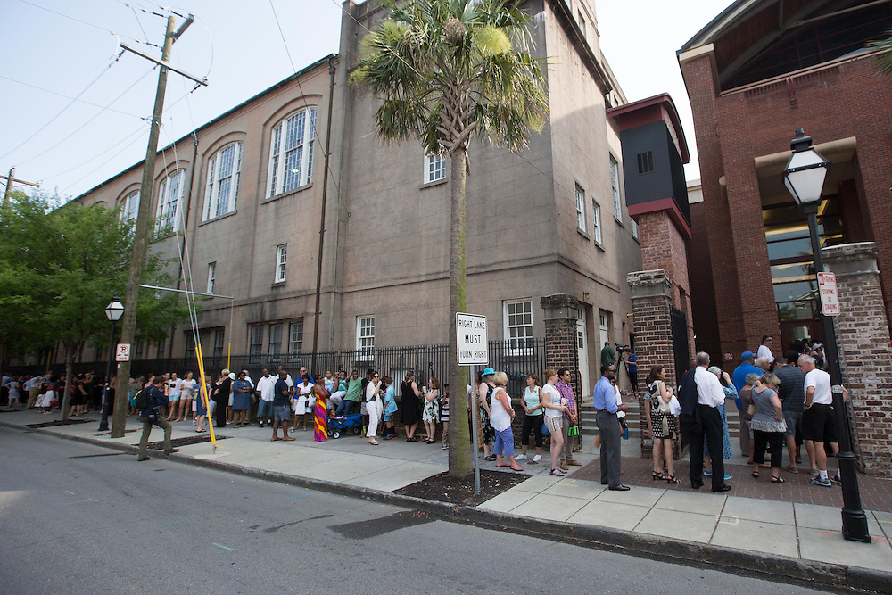 People wait to enter TD Arena on June 19, 2015 for a vigil for the nine people shot and killed inside Emanuel African Methodist Episcopal Church in Charleston, South Carolina. The victims were killed on June 17, 2015. A suspect, Dylann Roof, 21, was arrested in connection with the shootings. Photo by Kevin Liles/UPI