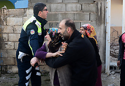 A rocket fired by the People's Protection Units (YPG) in Syria killed a 17-year-old girl after hitting the Reyhanlı district of the southern border province of Hatay on Jan. 31. Fatma Avlar succumbed to her wounds at the hospital after the attack, while 55-year-old Syrian refugee Nadir El Fares also died. Earlier, a rocket attack struck the wall of a house in the same Gultepe neighborhood, injuring another civilian who was taken to hospital for treatment. Two houses and several vehicles in the neighborhood were also damaged. Additionally, two other rocket attacks hit the neighborhood later on January 31, 2018, Reyhanli, Turkey. The rockets hit an empty house and the street and no casualties were reported. Photo by Ibrahim Mase/Dha/Depo Photos/ABACAPRESS.COM