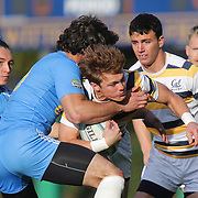 BERKELEY, CA - NOVEMBER 08:  Thomas Robles #1 of California is tackled during the PAC Rugby 7's Championship between UCLA and California at Witter Rugby Field at the University of California on November 8, 2015 in Berkeley, California. California won the match by a score of 17-5. (Photo by Alex Menendez/Getty Images) *** Local Caption *** Thomas Robles