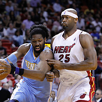 19 March 2011: Denver Nuggets center Nene Hilario (31) drives past Miami Heat center Erick Dampier (25) during the Miami Heat 103-98 victory over the Denver Nuggets at the AmericanAirlines Arena, Miami, Florida, USA.