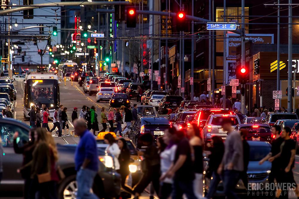 Photo of crowded city street; sidewalk and road traffic; Main Street, downtown Kansas City, Missouri.