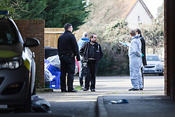 © Licensed to London News Pictures. 16/02/2018. London, UK. Police and forensic officers outside Garenne Court in Warren Road, Waltham Forest. A murder investigation has been launched after a man was found dead suffering from multiple injuries yesterday, 15th February. A 38 year old woman and a 63 year old man were arrested on suspicion of murder in the early hours of this morning.  Photo credit: Vickie Flores/LNP
