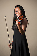 Pauline Do, MHS sophomore, poses for a portrait with her violin before performing in the Milpitas Unified School District's 11th Annual Music Festival at Milpitas High School in Milpitas, California, on April 10, 2014. (Stan Olszewski/SOSKIphoto)