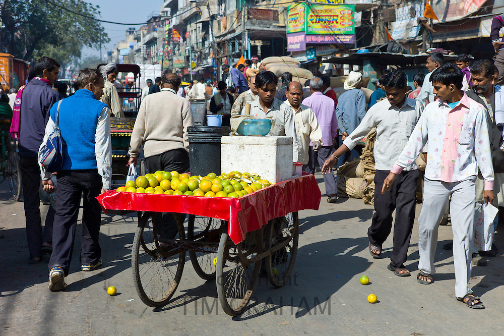 Oranges being sold from a cart at Khari Baoli in Old Delhi, India