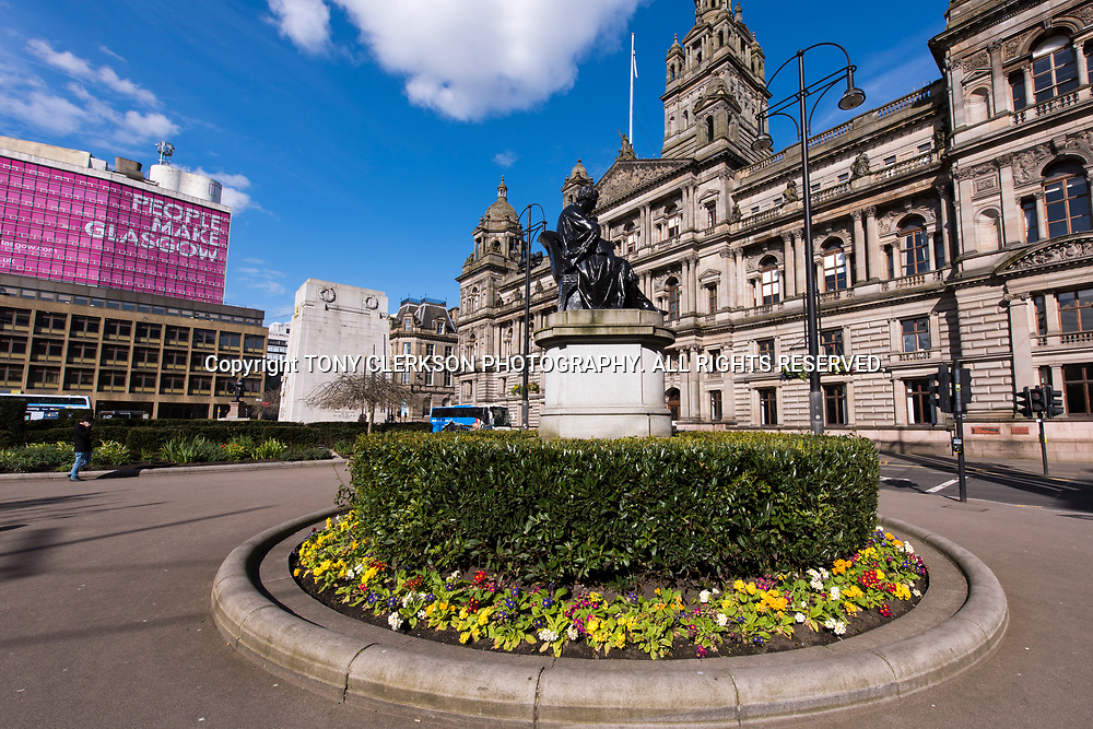 George Square and Glasgow City Chambers bask in the spring sunshine.