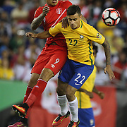 FOXBOROUGH, MASSACHUSETTS - JUNE 12: Jose Paolo Guerrero #9 of Peru and Philippe Coutinho #22 of Brazil cha;;edge for the ball during the Brazil Vs Peru Group B match of the Copa America Centenario USA 2016 Tournament at Gillette Stadium on June 12, 2016 in Foxborough, Massachusetts. (Photo by Tim Clayton/Corbis via Getty Images)