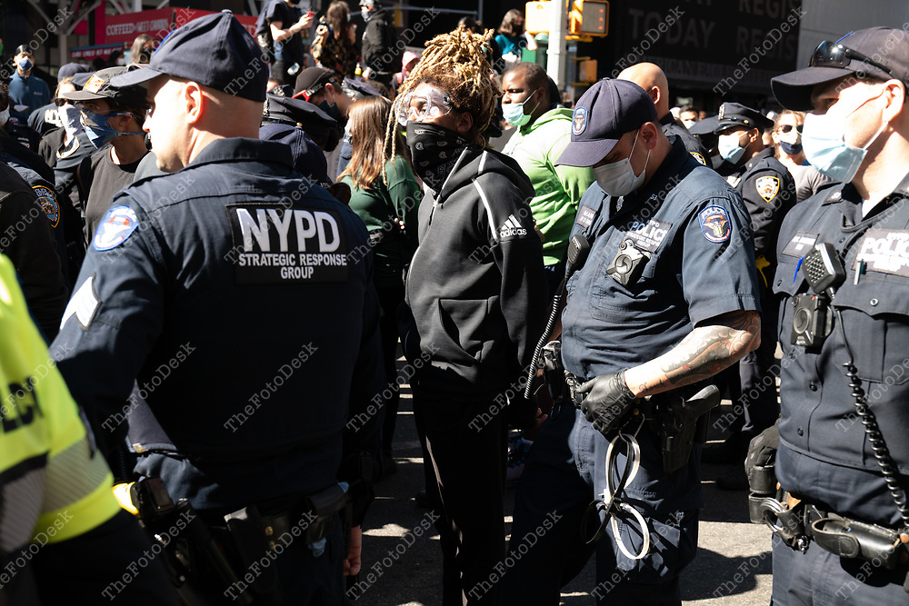 NEW YORK, NEW YORK: A demonstrators face off with New York City Police during a Black Lives Matter Movement Abolish Ice protest and rally at Times Square in New York, New York on Saturday, September 19, 2020.  Nearly 50 people were arrested during the protest. (©Brian Branch-Price/TheFotodesk)