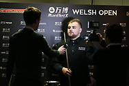 Jackson Page, the 16 year old amateur from South Wales is interviewed after his victory in his 1st round match against Sean O'Sullivan. ManBetx Welsh Open Snooker 2018, day 1 at the Motorpoint Arena in Cardiff, South Wales on Monday 26th February 2018.<br /> pic by Andrew Orchard, Andrew Orchard sports photography.