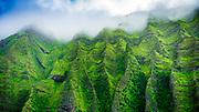 Lush canyon walls in Honopu Valley on the Na Pali Coast (aerial), Napali Coast Wilderness State Park, Kauai, Hawaii USA