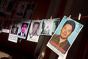 Pictures of disappeared migrants are held in Saltillo, Coahuila, on October 21st, 2012 (Photo: Prometeo Lucero)