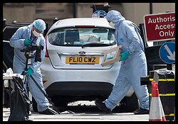 August 14, 2018 - London, London, United Kingdom - Image licensed to i-Images Picture Agency. 14/08/2018. London, United Kingdom.  Scenes of crime officers examine the car after it was crashed into a barrier outside the Houses of Parliament in London in what was thought to be a terror attack. (Credit Image: © Stephen Lock/i-Images via ZUMA Press)